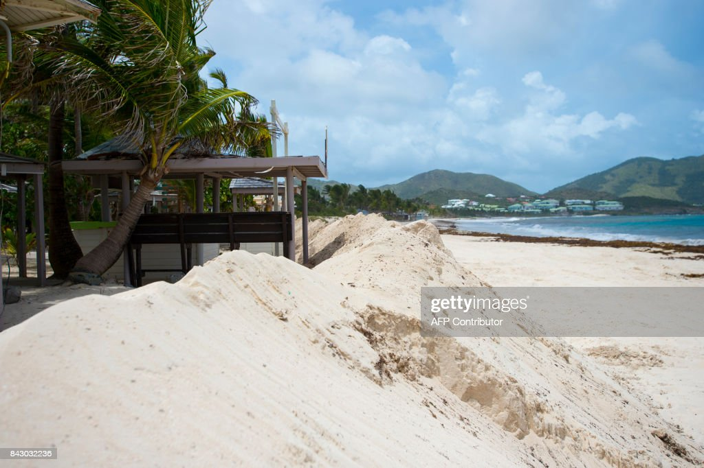 A Sand Seawall Is Placed In Front Of The Hotel KKO As Part Preparations For