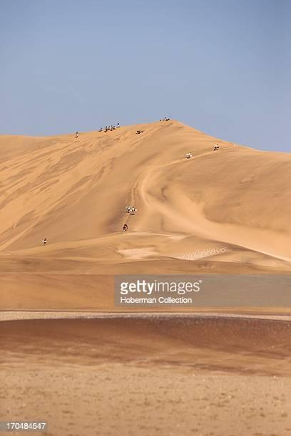 Sand skiers on sand dunes in namiba