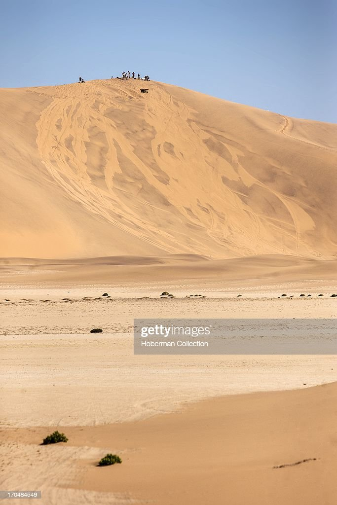 Sand skiiers on sand dune : News Photo