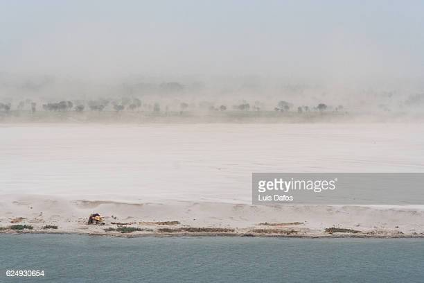 sand storm over deserted shore of ganges river - river ganges stock pictures, royalty-free photos & images