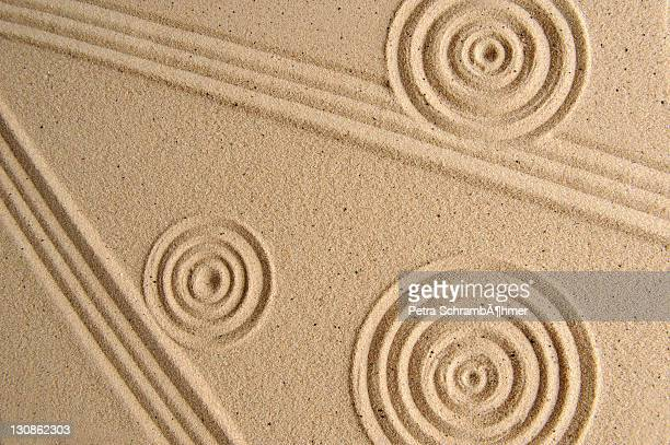 Sand texture, patterns drawn in sand