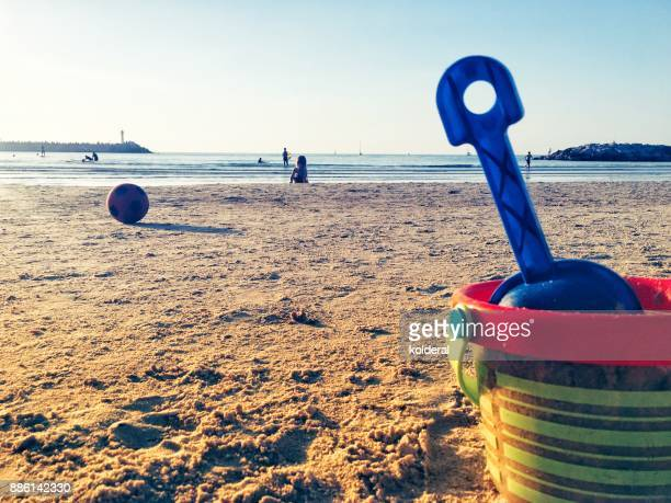Sand toys shovel and bucket on the Mediterranean beach