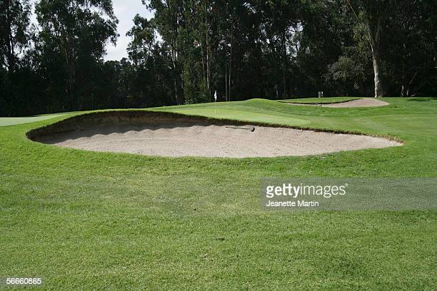 a sand trap in front of a green on a golf course - sand trap stock pictures, royalty-free photos & images