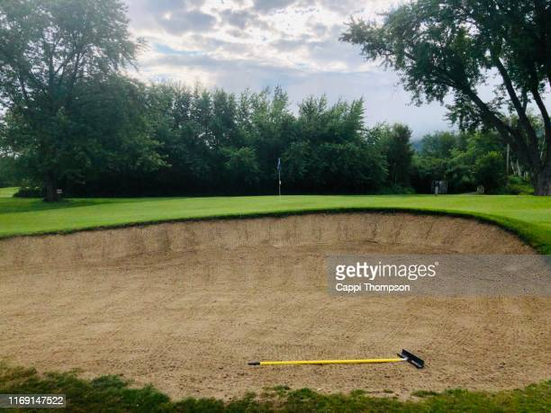 sand trap on golf course - sand trap stock pictures, royalty-free photos & images
