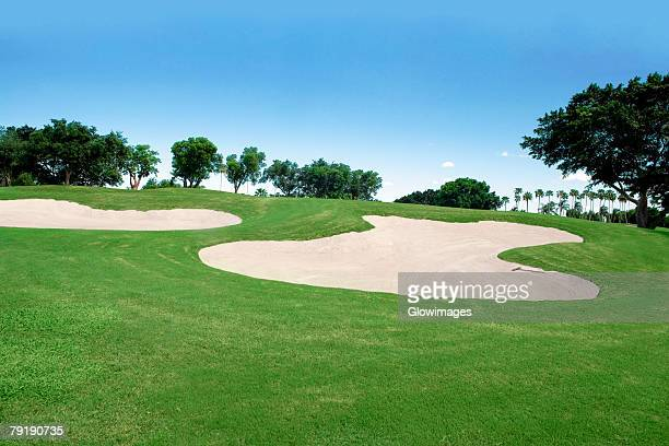 sand traps in a golf course - バンカー ストックフォトと画像