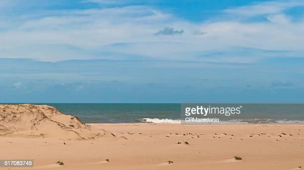 sand, water and sky. - crmacedonio stock-fotos und bilder