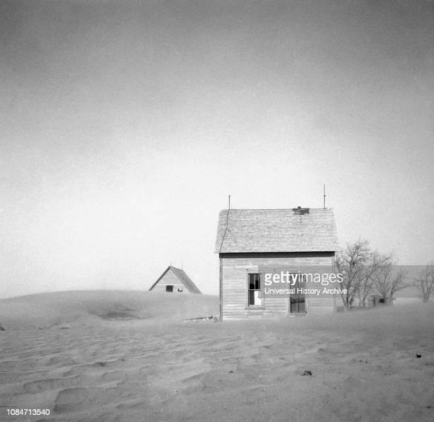 Sand Whirling Around House and Barn, Cimarron County, Oklahoma, USA, Arthur Rothstein, Farm Security Administration, April 1936.
