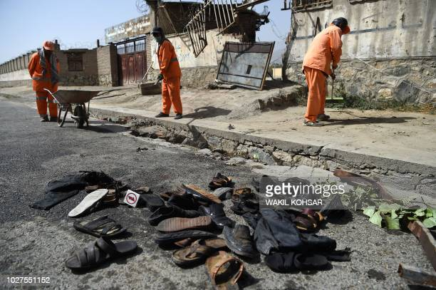 Sandals are seen laying on the ground along the street near the site of a suicide attack after a blast that targeted wrestlers during a training...