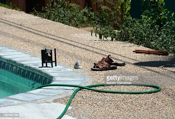 Sandals are seen next to a pool where Rodney King was found dead in the bottom of the pool on June 17, 2012 in Rialto, California. King, whose video...