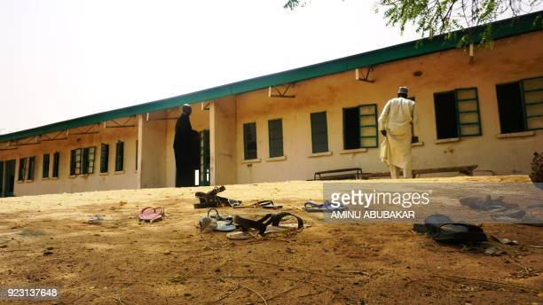 TOPSHOT Sandals are strewn in the yard of the Government Girls Science and Technical College staff quarters in Dapchi Nigeria on February 22 2018...