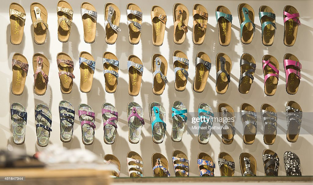Sandals of German brand Papillion, manufactured by Birkenstock, are displayed at the booth of an exhibitor at the Bread and Butter trade show at the former Tempelhof airport on July 08, 2014 in Berlin, Germany.