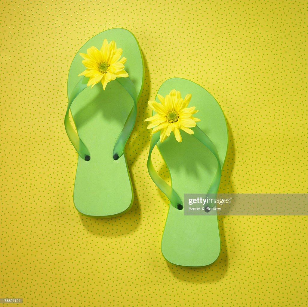Sandals with flowers : Stock Photo