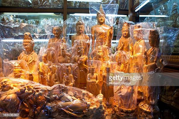 sandalwood buddha statues, bogyoke aung san market - sandalwood stock pictures, royalty-free photos & images