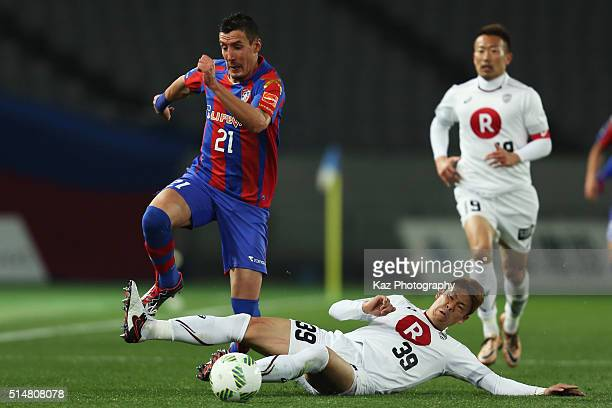 Sandaza of FC Tokyo and Masahiko Inoha of Vissel Kobe compete for the ball during the JLeague match between FC Tokyo and Vissel Kobe at the Ajinomoto...