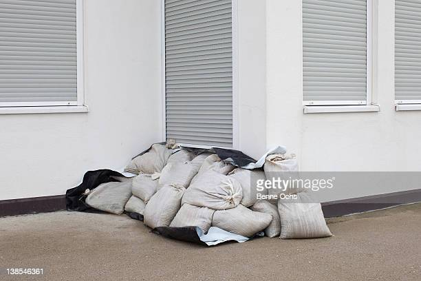 sandbag stack to stop flooding - sandbag stock pictures, royalty-free photos & images