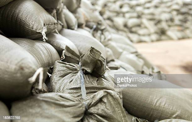 sandbag wall prepared for a major river flood - sandbag stock pictures, royalty-free photos & images
