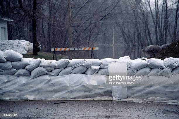 sandbags along river, spring flood, mn - sandbag stock pictures, royalty-free photos & images