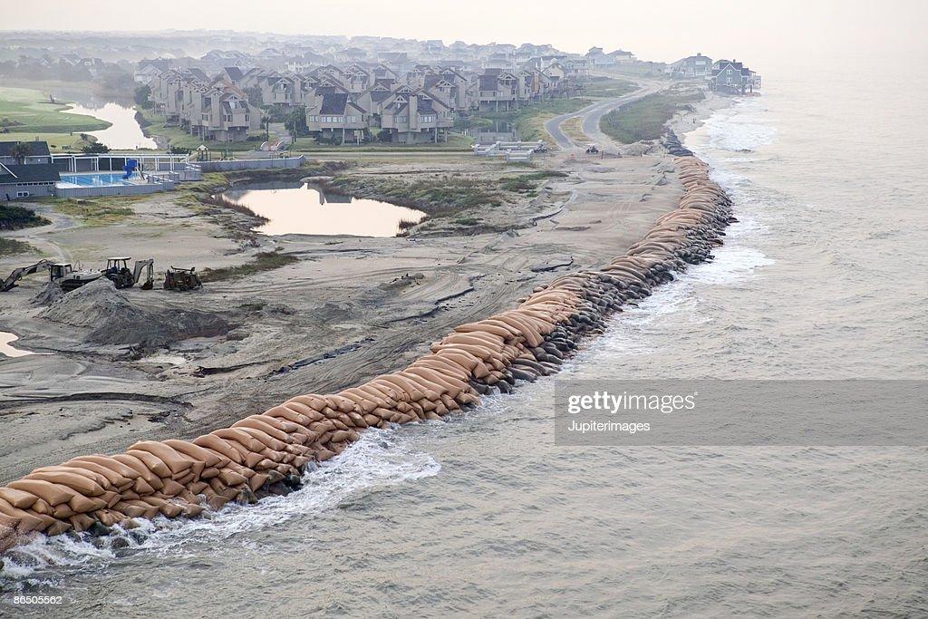 Sandbags along shore of resort, Bald Head Island, North Carolina : Stock Photo