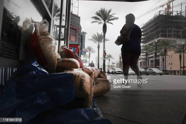Sandbags are piled outside of a store in anticipation of Tropical Storm Barry on July 12 2019 in New Orleans Louisiana The slow moving storm is...