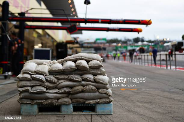 Sandbags are seen outside the Red Bull Racing garage after practice for the F1 Grand Prix of Japan at Suzuka Circuit on October 11, 2019 in Suzuka,...
