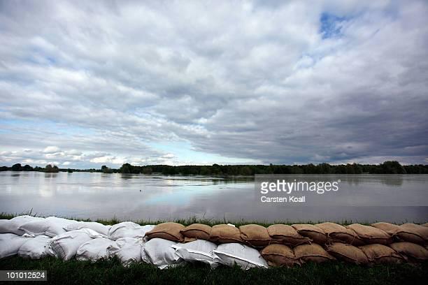 Sandbags lies on the dike tip close to the flooden river Oder on May 27 2010 in Neuzelle near Frankfurt Germany German authorities have raised their...