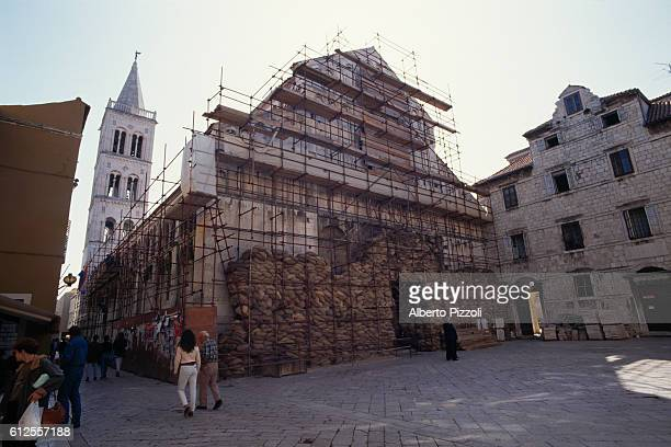 Sandbags protect a church from bombardments and combat in the Croatian city of Zadar.