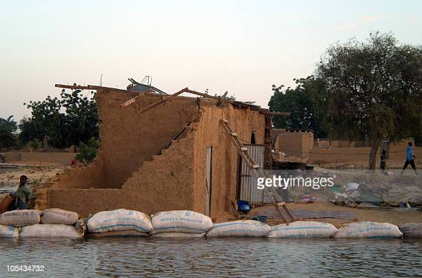 Sandbags protect a house on October 12 2010 near a flooded area of the Chadian capital N'Djamena after the Chari river left its bed on October 11...