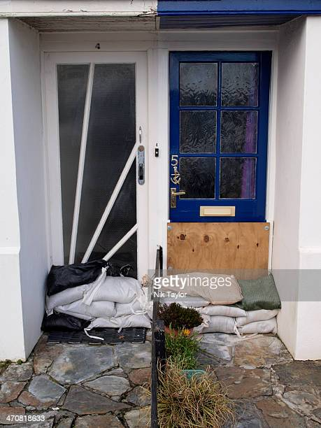 CONTENT] Sandbags protecting houses from flooding Bude Cornwall UK