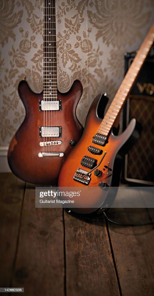 A Sandberg Florence Aged electric guitar (L) and Suhr Guthrie Govan Antique Modern electric guitar, studio shoot for Guitarist Magazine, September 22, 2011.