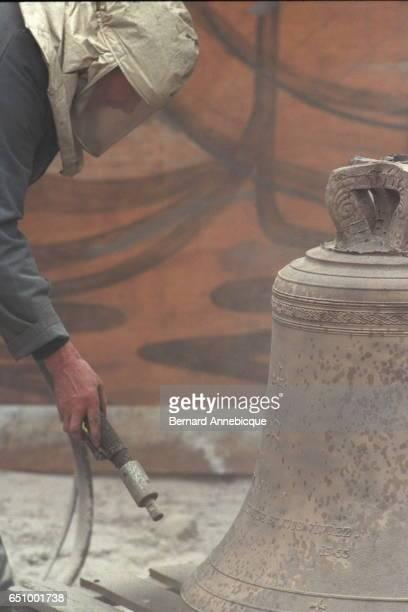 Sandblasting the bell