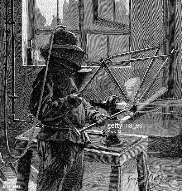 Sandblasting the joints of a bicycle frame operator wears helmet with breathing tube and a protective tunic France Wood engraving Paris 1896