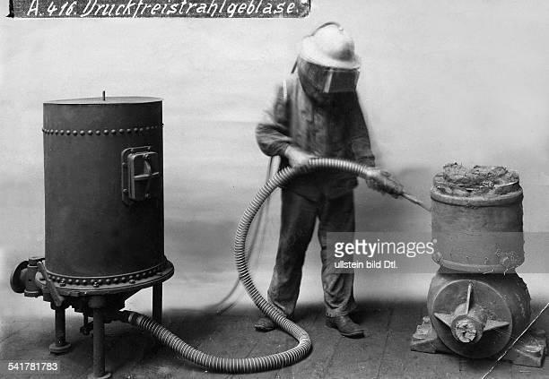 Sandblasting worker in protective clothing using the compressor Photographer Badische Maschinenfabrik Eisengiesserei Published by 'Tempo' Vintage...