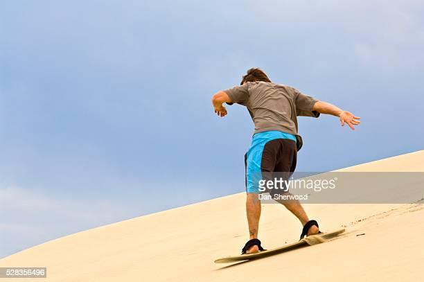 sandboarding, honeyman state park, oregon, usa - dan sherwood photography stock pictures, royalty-free photos & images