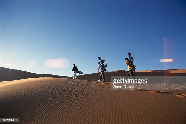 sand-boarding in the sahara - merzouga stock pictures, royalty-free photos & images