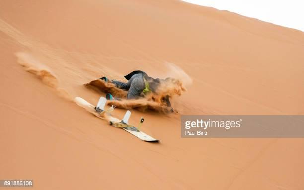 Sand-boarding the Saharan sand dunes, Merzouga, Morocco