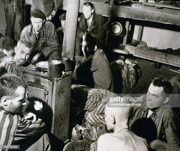 II Sandbostel Concentration Camp Political prisoners and British troops inside a bunkhouse in STALAG XB camp Germany