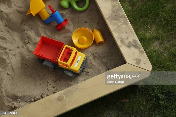 A sandbox with a child's toys lies in a garden on August 31 2017 in Berlin Germany With approximately three weeks to go before federal elections in...