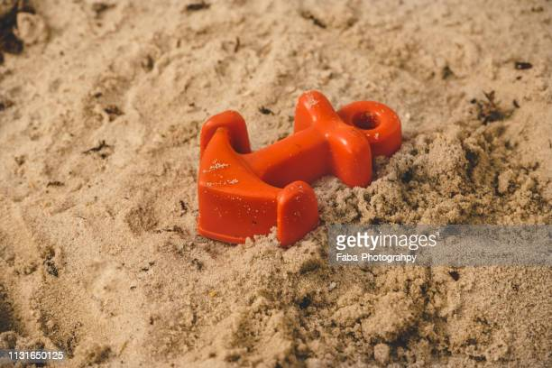 sandbox with toys - plastikmaterial stockfoto's en -beelden
