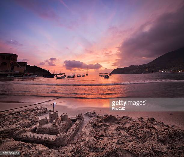 Sandcastle And Bay At Sunset