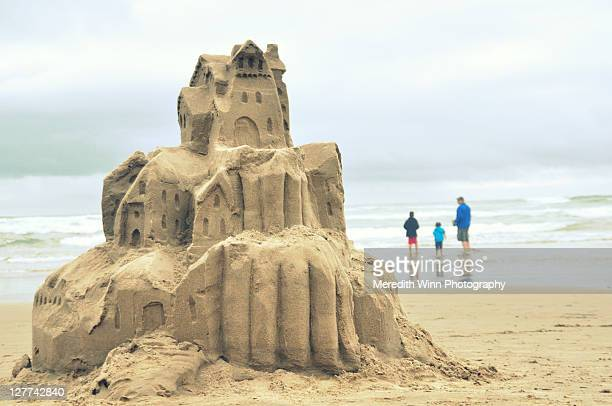 Sandcastle and family at Cannon Beach in Oregon