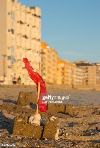 Sandcastle by the urban beach