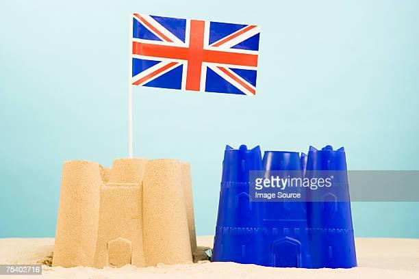 Château de sable avec drapeau britannique