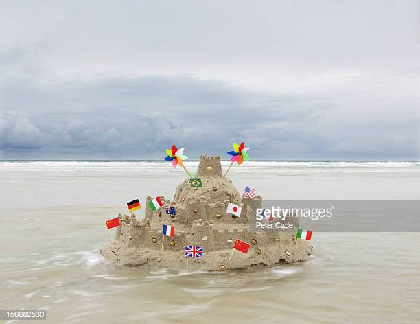 sandcastle with flags from multiple countries - cornish flag stock pictures, royalty-free photos & images