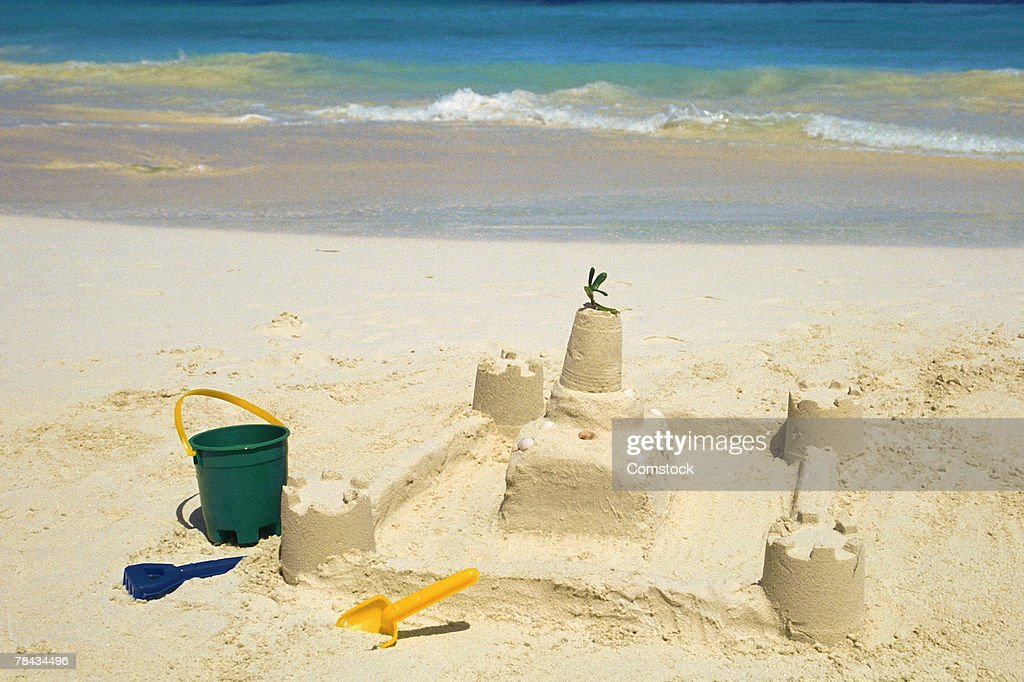 Sandcastle with pail and shovel : Stockfoto