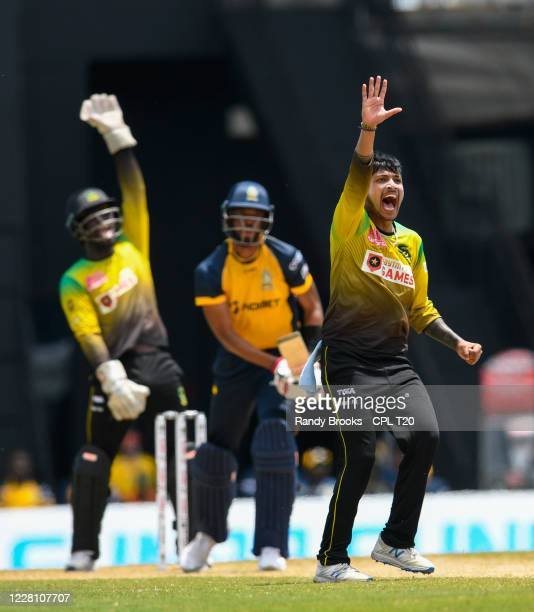 Sandeep Lamichhane of Jamaica Tallawahs appeal for lbw against Roston Chase of St Lucia Zouks during the Hero Caribbean Premier League match 3...