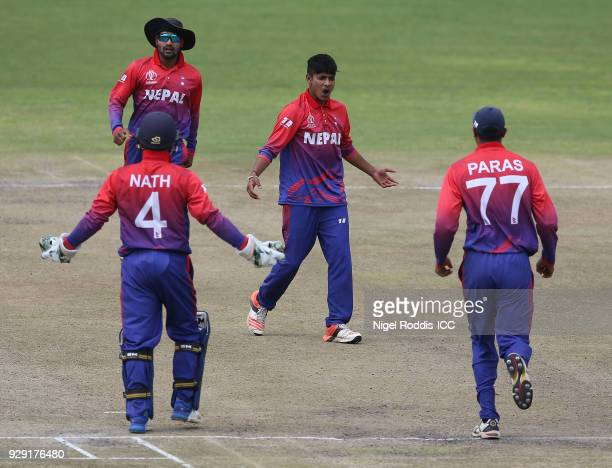 Sandeep Lamichhane of Nepal celebrates taking the wicket of Richie Berrington of Scotland during the ICC Cricket World Cup Qualifier between Scotland...
