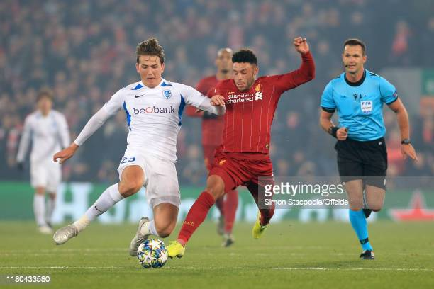Sander Berge of Genk battles with Alex OxladeChamberlain of Liverpool during the UEFA Champions League group E match between Liverpool FC and KRC...