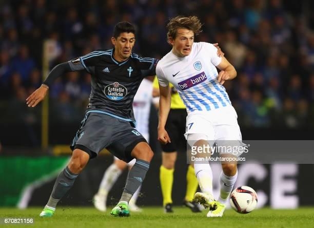 Sander Berge of Genk beats Pablo Hernandez of Celta Vigo to the ball during the UEFA Europa League quarter final second leg between KRC Genk and...
