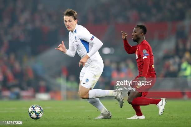 Sander Berge of KRC Genk challenges for the ball with Naby Keita of Liverpool during the UEFA Champions League group E match between Liverpool FC and...