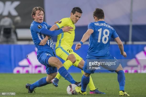 Sander Berge of KRC Genk Jeremy Perbet of KAA Gent Ruslan Malinovskiy of KRC Genkduring the UEFA Europa League round of 16 match between KAA Gent and...